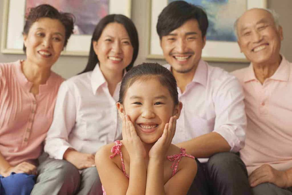 Girl Smile Front of Family Members