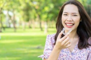 patient-wearing-invisalign-clear-aligners