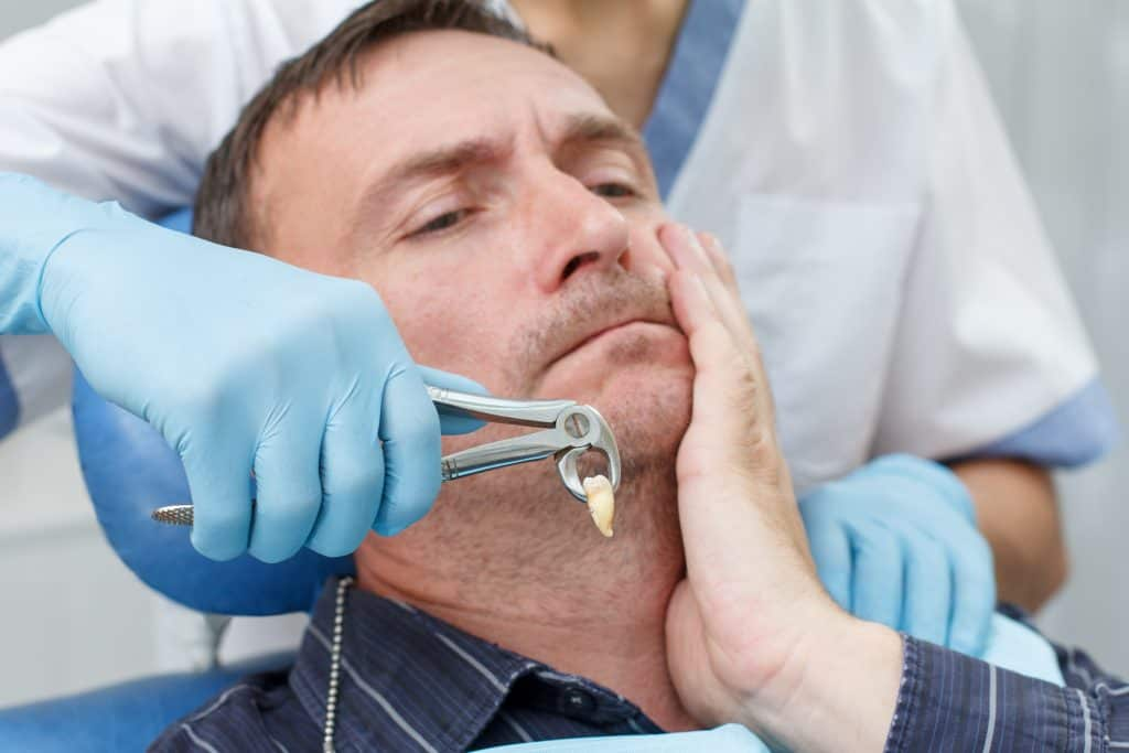 a patient undergoing tooth extraction